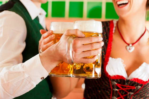 Man and woman with beer glass in brewery Premium Photo