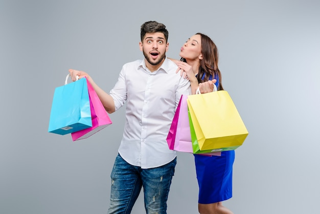 Man and woman with shopping bags they got on a sale Premium Photo