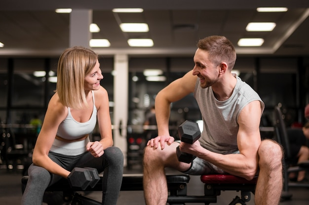 Man and woman working out together Free Photo