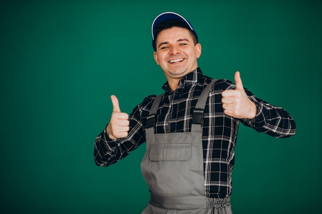 Man worker in hat isolated on green wall Free Photo