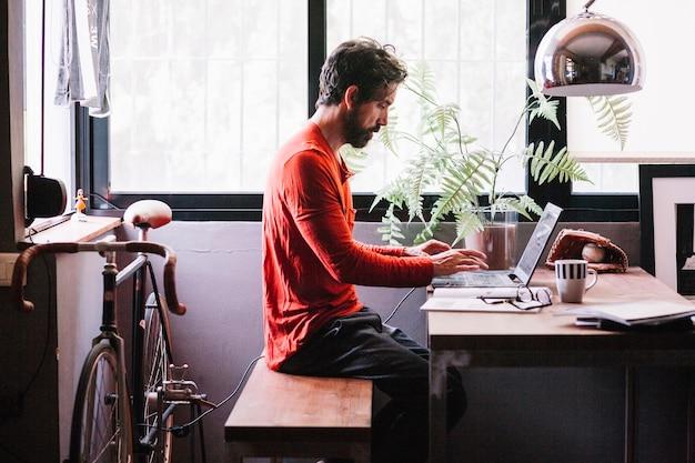 Man working at desk Free Photo