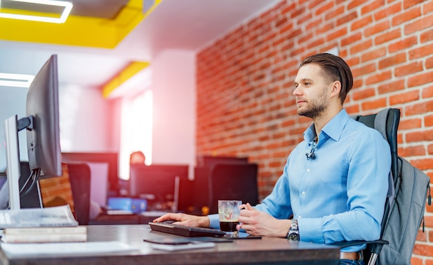 Man working on desktop computer with many monitors at office Premium Photo