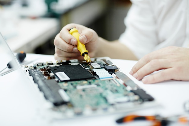 Man working on electronics Free Photo