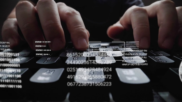 Man working on laptop computer keyboard with graphic user interface Premium Photo
