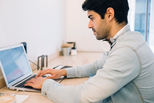Man working on computer Free Photo