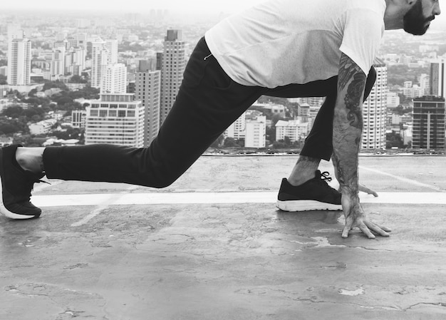 Man working out on the rooftop Free Photo