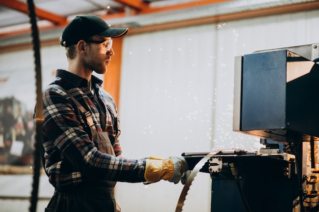 Man working on steel fatory and equipment for steel production Free Photo