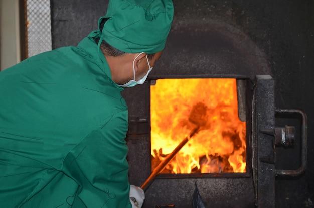 Man working with incinerator Premium Photo