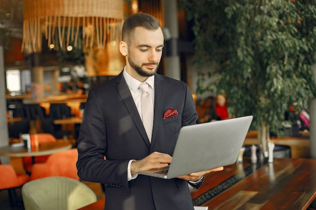Man working with a laptop at the table Free Photo