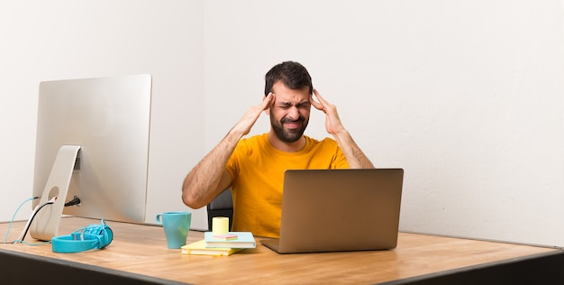 Man working with laptot in a office unhappy and frustrated with something Premium Photo