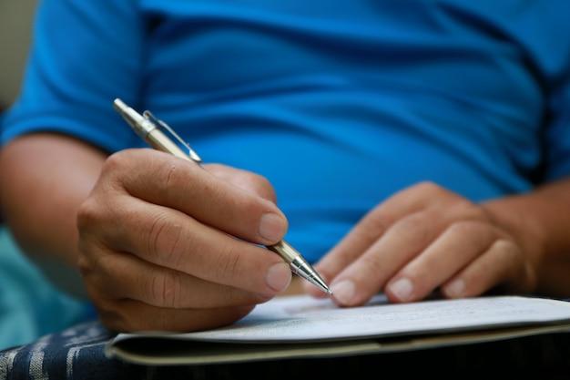 Man write pen on document paper Premium Photo
