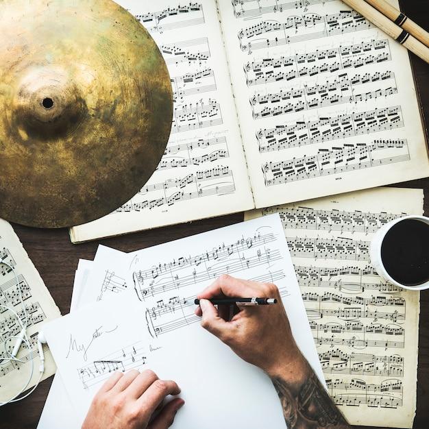 Man writing musical notes Premium Photo