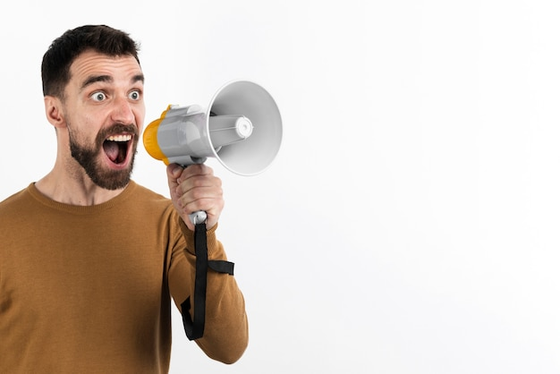 Man yelling through megaphone Free Photo