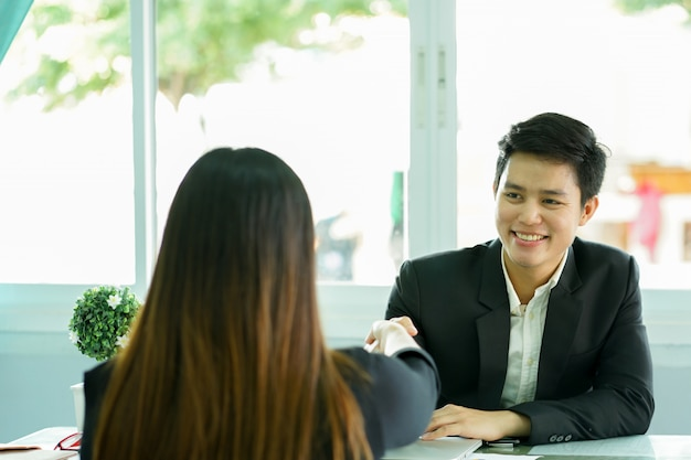 Manager man hand shake with graduated person after job interview Premium Photo