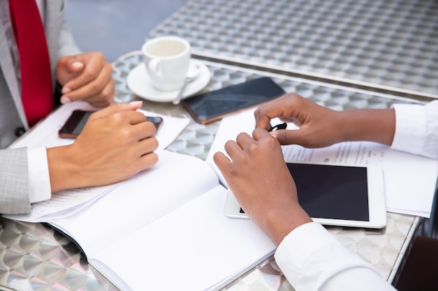 Managers sitting at table with documents and digital devices Free Photo