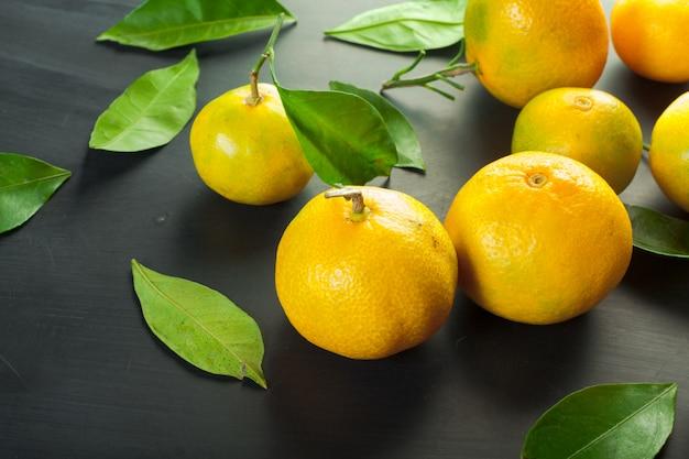 Mandarins on a black background Premium Photo