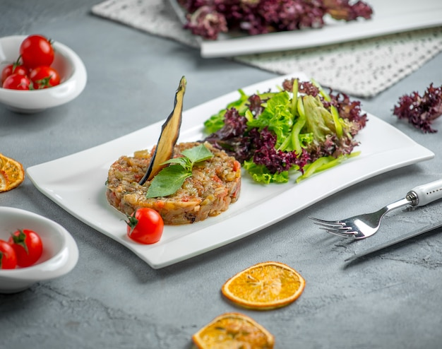 Mangal salad with vegetables in the plate Free Photo