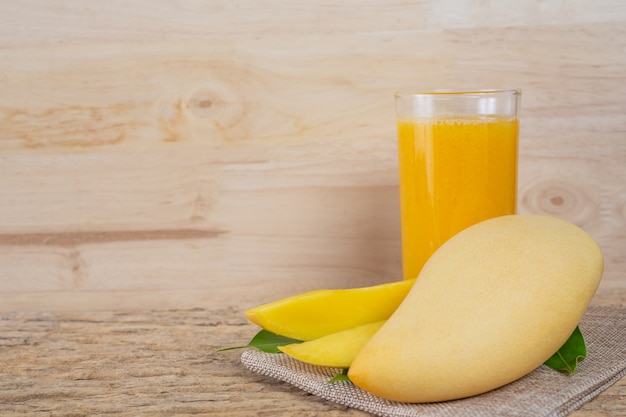 Mango juice on the wooden floor table. Free Photo
