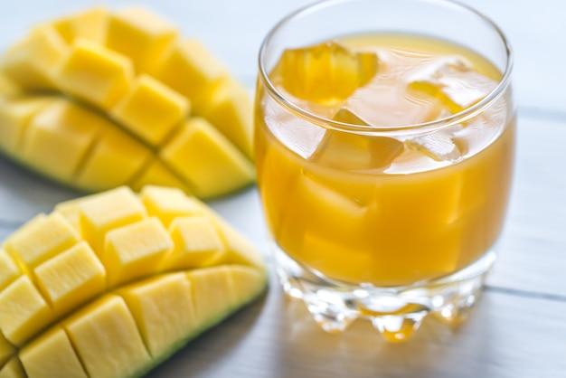 Mango juice on the wooden table Premium Photo
