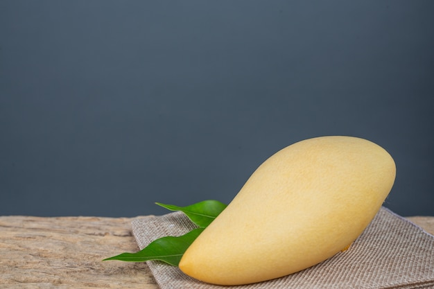Mango placed on wooden floor. Free Photo