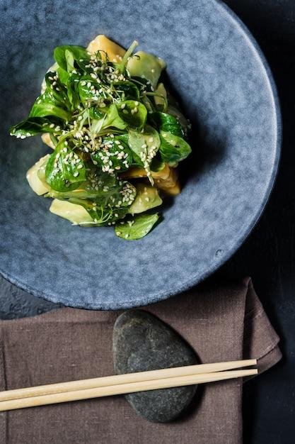 Mango salad, avocado, lettuce Premium Photo