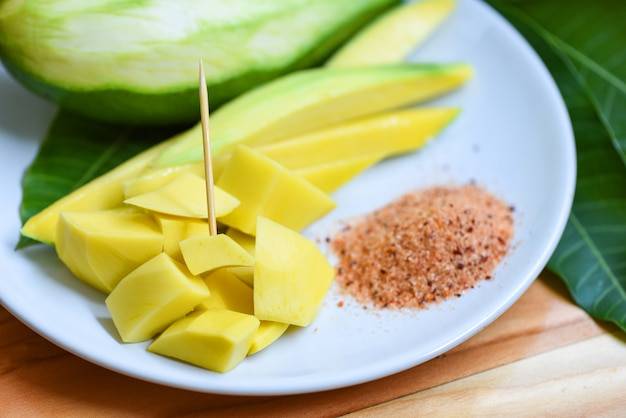 Premium Photo   Mango slice on white plate and leaves from tree tropical  summer fruit concept - ripe mango pickled fruit and green mangoes for snack