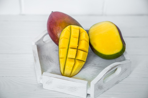 Mango on white wooden background Free Photo