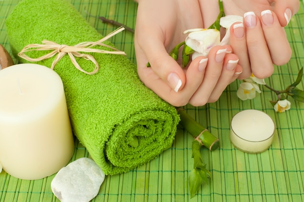 Manicure - hands with natural nails, beauty salon background Premium Photo