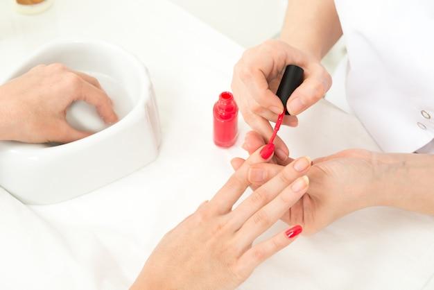 Manicure process closeup Free Photo