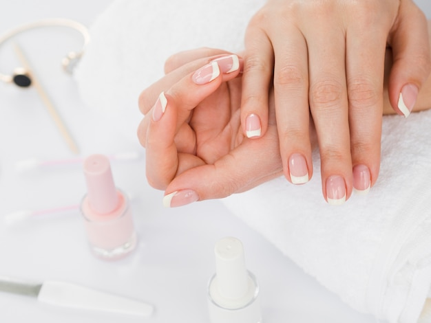 Manicured hands and nail polish Free Photo