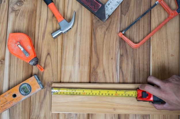 Manual tool set, set on wooden floor. Free Photo