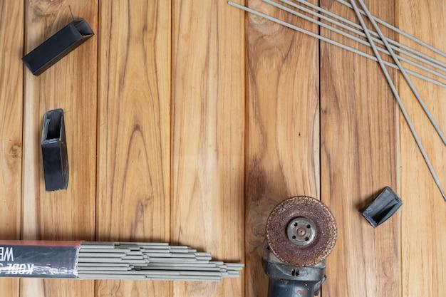 Manual tool set, set on wooden floor. Free Photo
