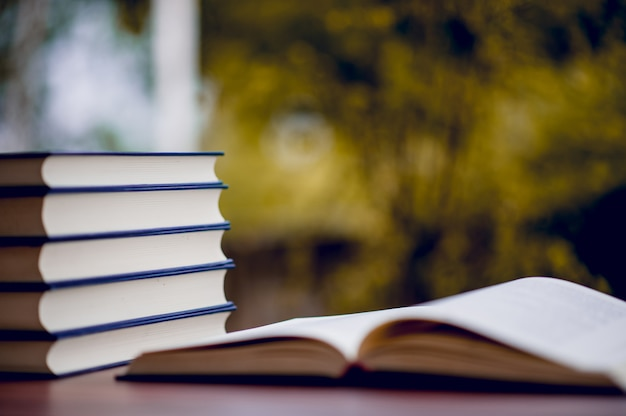 Many books are placed on the table, school supplies. education concept Premium Photo