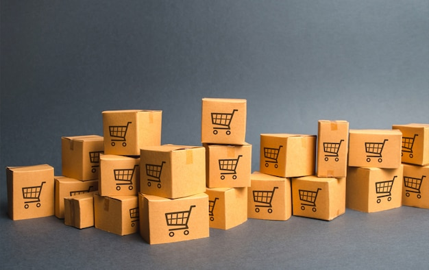 Many cardboard boxeswith drawing of shopping carts. products, goods Premium Photo