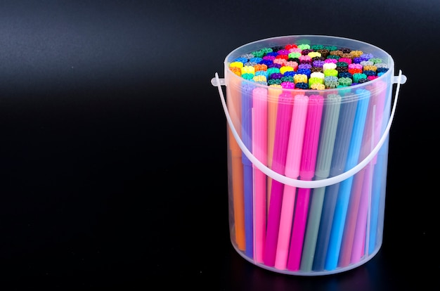 Many colored markers in package. studio photo Premium Photo