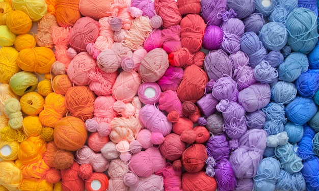 Many colorful balls of wool and cotton yarns Premium Photo