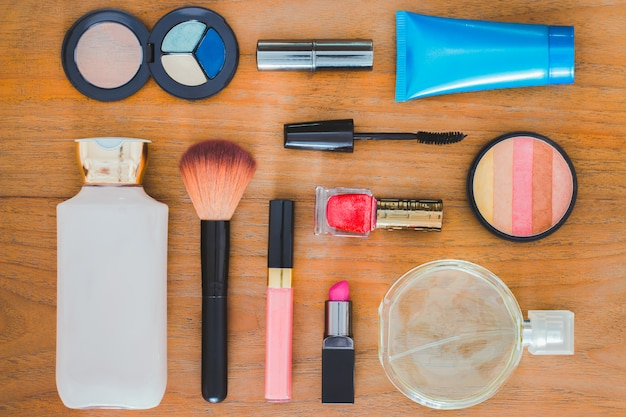 Many cosmetics and containers on a wooden floor Premium Photo