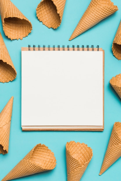 Many empty waffle cones and notebook Free Photo