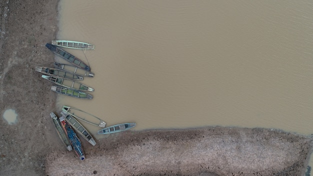 Many fishing boats in the river taken from the top Free Photo