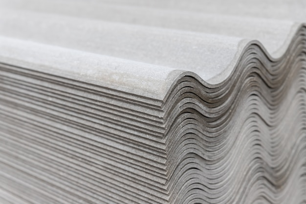 Many gray slate sheets are stacked on top of each other. wavy stripes pattern Premium Photo