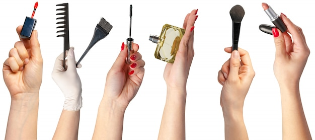 Many hands with make up items Premium Photo