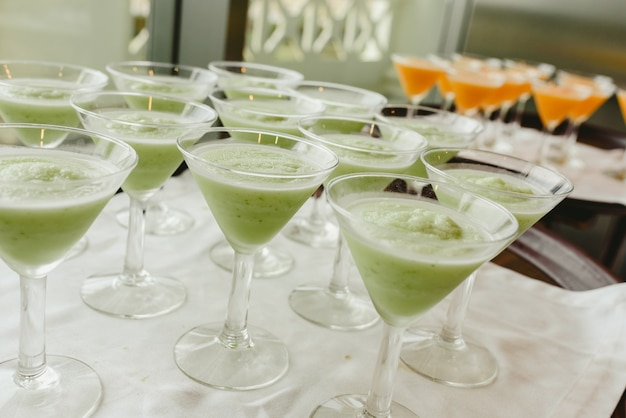 Many ice cream glasses ready to be served by a waiter during a wedding. Premium Photo