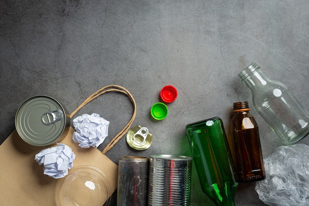 Many kinds of garbage were scattered on the dark floor. Free Photo