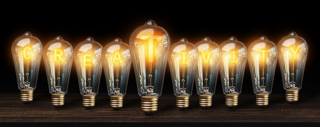 Many light bulbs on dark background | Premium Photo