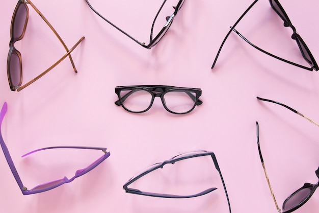 Many pairs of glasses on pink background Free Photo