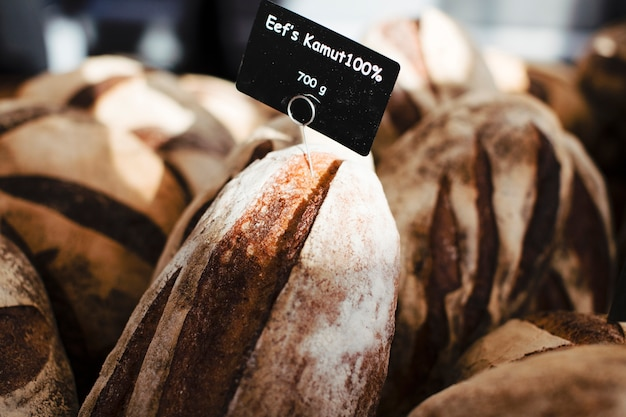 Many rustic baked bread with black tag Free Photo