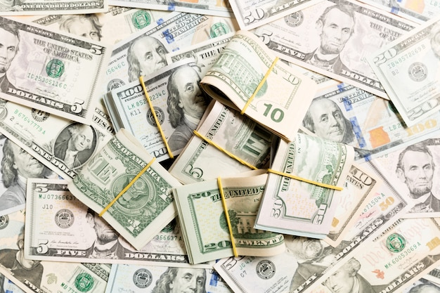 Many stack of 100 dollar bills on dollars  top wiev with copyspace Premium Photo