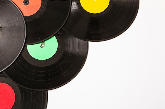 Many vinyl records on white background Free Photo
