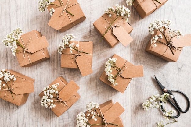 many wedding gift boxes with scissor on wooden background photo