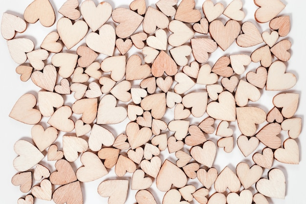 Many wooden hearts valentines day background. top view. Premium Photo